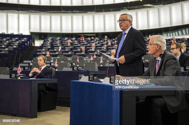 European Commission President JeanClaude Juncker delivers a speech as European Chief Negotiator for Brexit Michel Barnier and former leader of the UK...