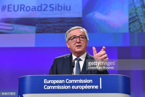 European Commission President JeanClaude Juncker gestures as he delivers a speech during a press conference at the European Commission in Brussels on...