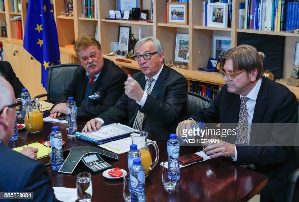 European Commission President JeanClaude Juncker gestures during a meeting with the European Union's chief Brexit negotiator Guy Verhofstadt and his...