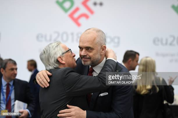 European Commission President JeanClaude Juncker greets Albania's Prime Minister Edi Rama as they attend the EUWestern Balkans Summit in Sofia on May...