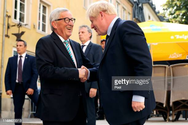 European Commission President Jean-Claude Juncker greets British Prime Minister Boris Johnson at the European Commission Representation on September...