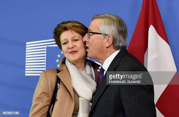 European Commission President JeanClaude Juncker greets Switzerland Presidentelect Simonetta Sommaruga at the European Commission headquarters in...