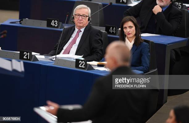 European Commission President JeanClaude Juncker listens to Bulgarian Prime Minister Boiko Borissov as he delivers a speech to present the incoming...