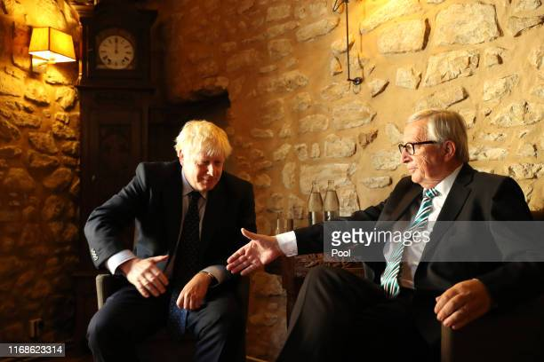 European Commission President Jean-Claude Juncker poses with British Prime Minister Boris Johnson prior to a meeting at a restaurant on September 16,...