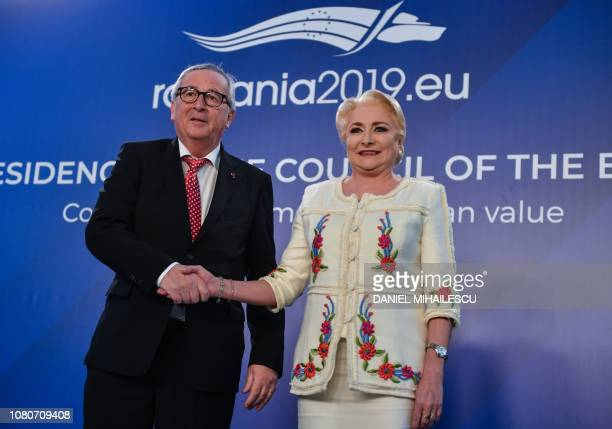European Commission President JeanClaude Juncker shakes hands with Romanian Prime Minister Viorica Dancila at The Victoria Palace the Romanian...