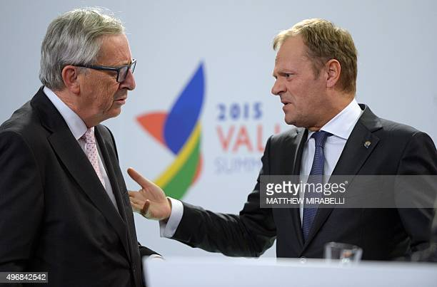 European Commission President Jean-Claude Juncker speaks with European Council President Donald Tusk after a press conference following an Informal...