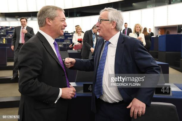 European Commission President JeanClaude Juncker speaks with member of the European Parliament and former leader of the antiEU UK Independence Party...