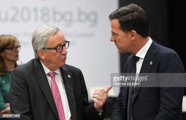 European Commission President JeanClaude Juncker speaks with Netherlands' Prime Minister Mark Rutte attends the EUWestern Balkans Summit in Sofia on...