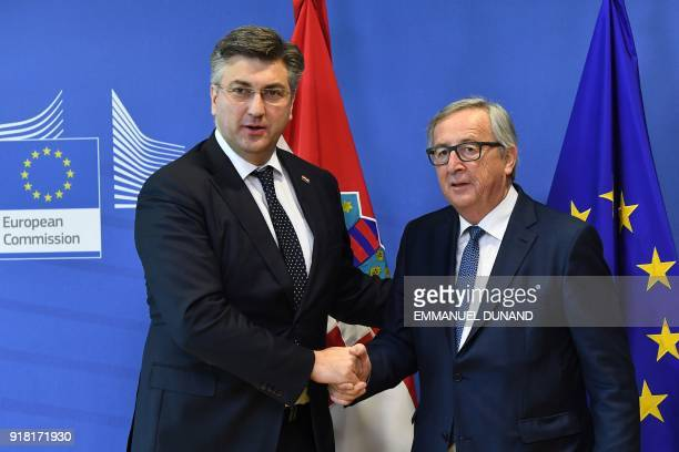 European Commission President JeanClaude Juncker welcomes and shake hands with Croatian Prime Minister Andrej Plenkovic ahead of a meeting at the...