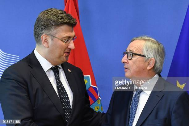 European Commission President JeanClaude Juncker welcomes Croatian Prime Minister Andrej Plenkovic ahead of a meeting at the European Commission in...