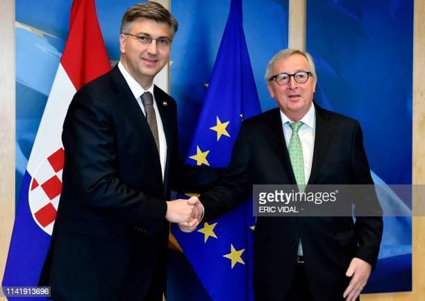 European Commission President JeanClaude Juncker welcomes Croatia's Prime Minister Andrej Plenkovic in Brussels on May 7 2019