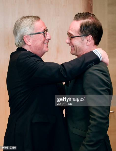 European Commission President JeanClaude Juncker welcomes German Foreign minister Heiko Maas before a meeting on April 13 2018 at the EU Headquarters...