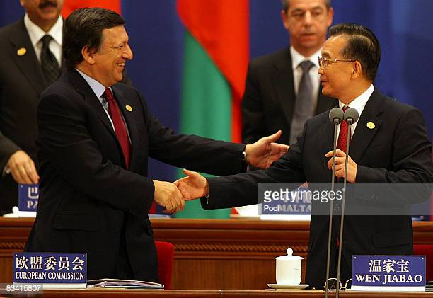 European Commission President Jose Manuel Baroso shakes hands with Chinese Premier Wen Jiabao during the Opening ceremony for the 7th Asia Europe...