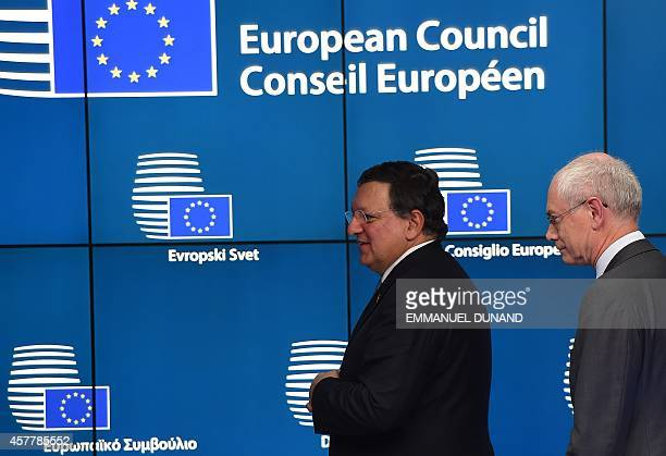 European Commission President Jose Manuel Barroso and European Council President Herman Van Rompuy leave after addressing a press conference at the...