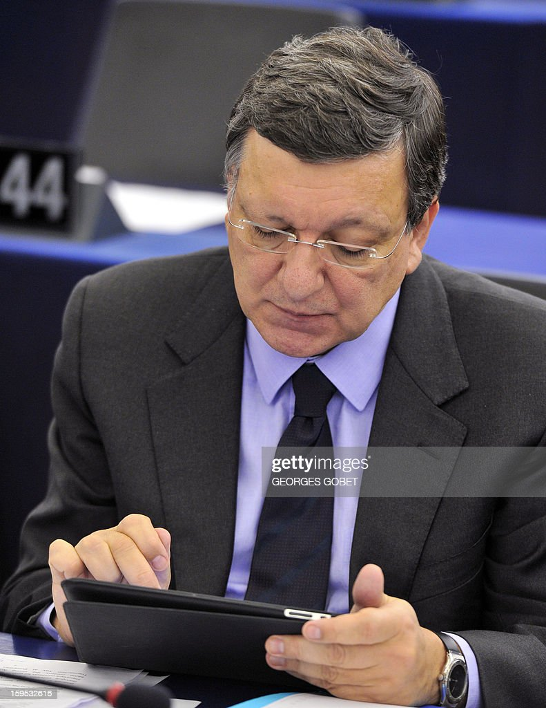 European Commission President Jose Manuel Barroso consults his tablet prior to a debate on the future of European Union at the European Parliament in Strasbourg on January 15, 2013 during a plenary session.
