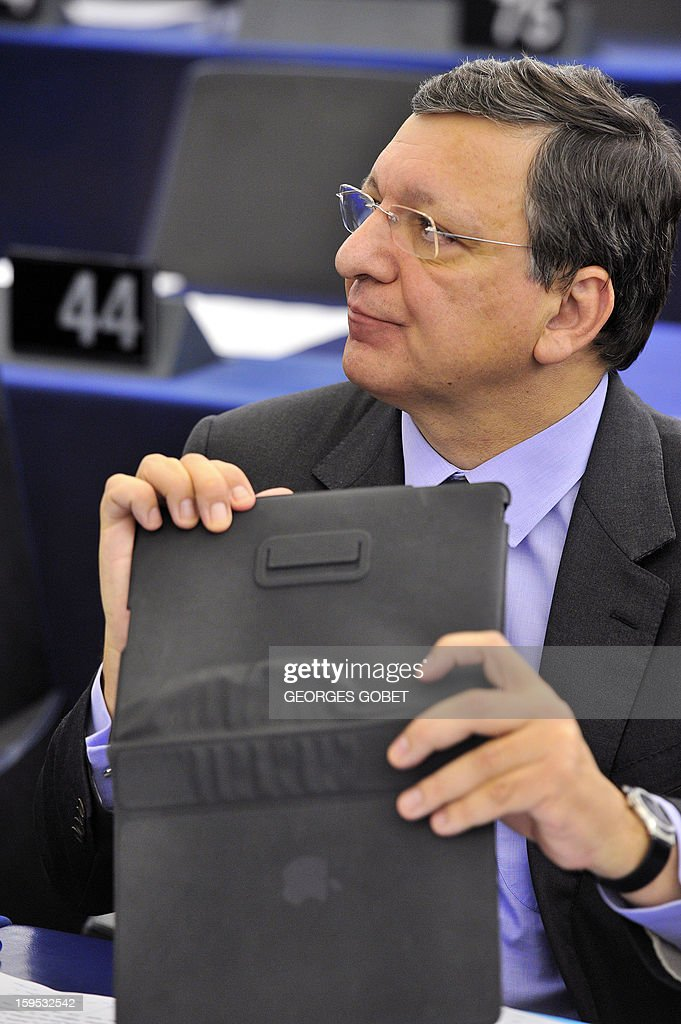 European Commission President Jose Manuel Barroso holds his tablet prior to a debate on the future of European Union at the European Parliament in Strasbourg on January 15, 2013 during a plenary session.