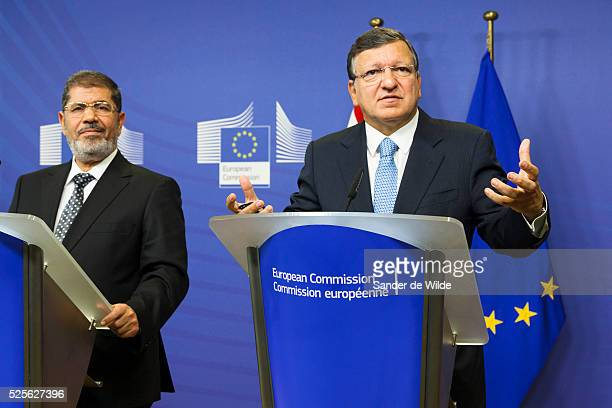 European Commission President Jose Manuel Barroso, right, and the Egyptian President Mohamed Morsi speak to the press prior to a meeting at the EU...