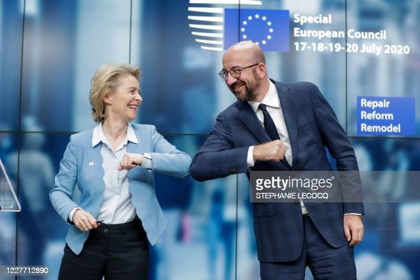 European Commission President Ursula Von Der Leyen and European Council President Charles Michel bump elbows at the end of the news conference...