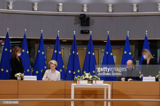 European Commission President Ursula von der Leyen and European Council President Charles Michel sign in Brussels, on December 30 the Brexit trade...