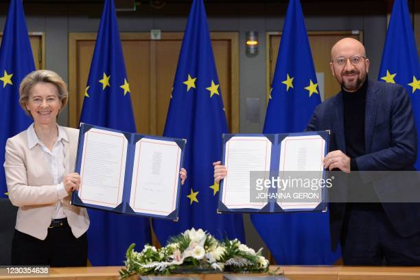 European Commission President Ursula von der Leyen and European Council President Charles Michel pose in Brussels, on December 30, 2020 as they show...