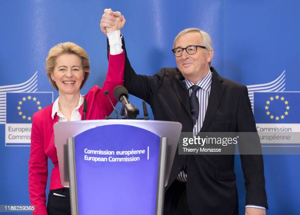 European Commission President Ursula Von Der Leyen and the former President of the EU Commission Jean-Claude Juncker attend the official handover...