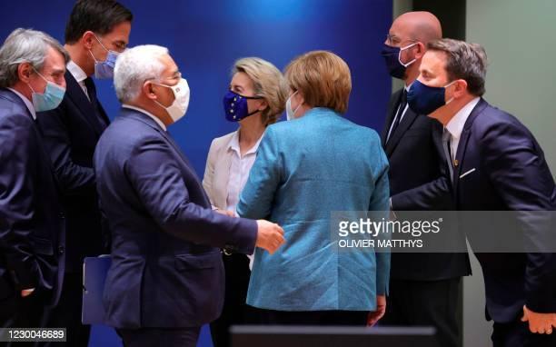 European Commission President Ursula von der Leyen, center left, and German Chancellor Angela Merkel, center right, speak with other EU heads of...