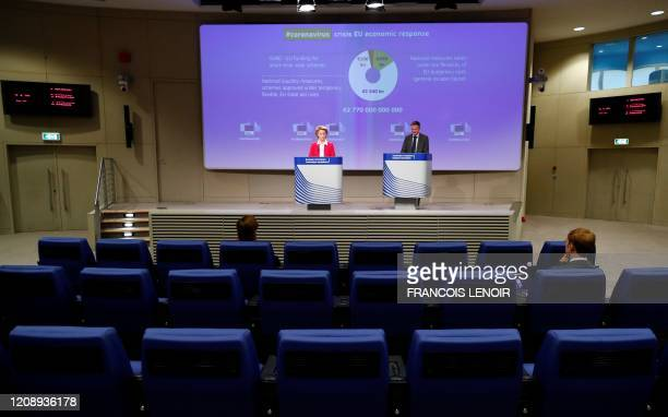 European Commission President Ursula von der Leyen gives a press conference on EU efforts to limit economic impact of the coronavirus disease...
