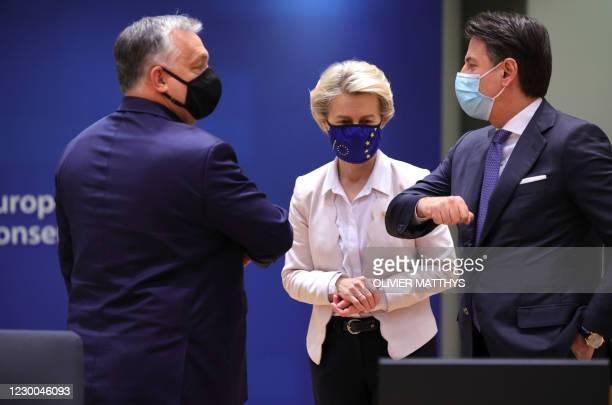 European Commission President Ursula von der Leyen looks on as Hungary's Prime Minister Viktor Orban greets Italy's Prime Minister Giuseppe Conte...