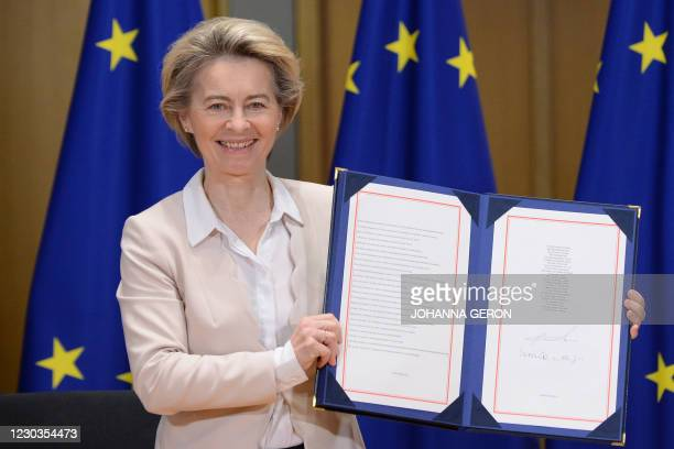 European Commission President Ursula von der Leyen poses for pictures in Brussels, on December 30 as she shows in Brussels, on December 30, 2020 the...