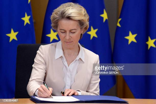 European Commission President Ursula von der Leyen signs, in Brussels, on December 30 the Brexit trade agreement due to come into force on January 1,...