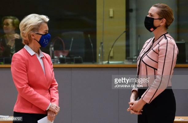 European Commission President Ursula von der Leyen speaks with Denmark's Prime Minister Mette Frederiksen during the second day of a European Union...