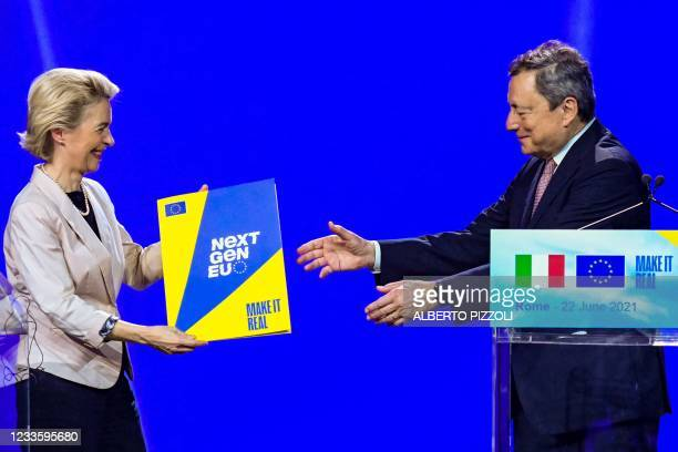European Commission President, Ursula von der Leyen symbolically hands to Italy's Prime Minister, Mario Draghi the NextGenerationEU recovery plan...