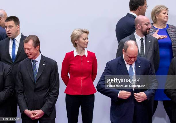 European Commission President Ursula von der Leyen wait to pose amid other leaders for a family picture during the opening day of the UNFCCC COP25...
