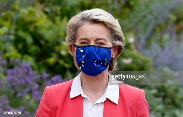 European Commission President Ursula von der Leyen wearing a protective face mask arrives to meet French President Emmanuel Macron prior to a meeting...