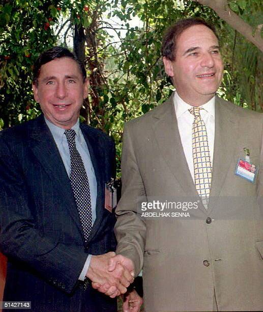 European Commission spokesman Sir Leon Brittan shakes hands with US Trade Representative Mickey Kantor prior to a bilateral meeting 12 April 1994 in...