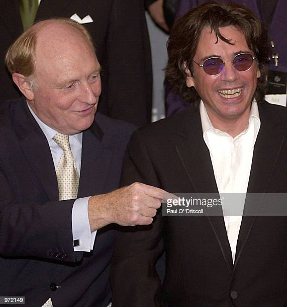 European Commission Vice President Neil Kinnock and Jean Michel Jarre share a joke during the International Federation of Phonographic Industries...