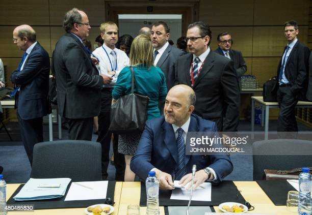 European Commissioner for Economic and Financial Affairs Pierre Moscovici attends a meeting of the Eurogroup finance ministers in Brussels on July 12...