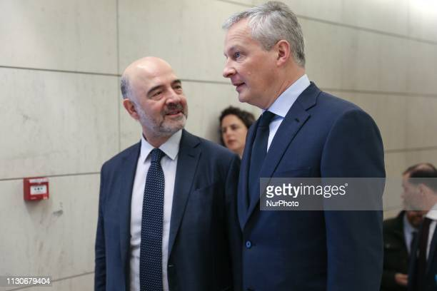 European Commissioner for Economic and Financial Affairs Pierre Moscovici and French Finance and Economy Minister Bruno Le Maire take part in a...