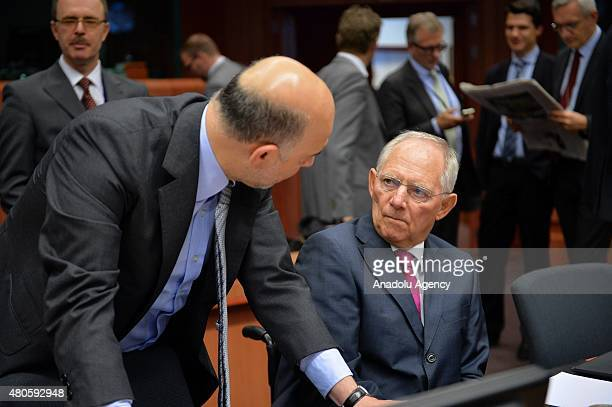 European Commissioner for Economic and Financial Affairs Pierre Moscovici and German Finance Minister Wolfgang Schauble at the start of the Eurogroup...