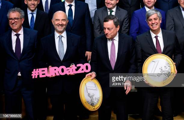 European Commissioner for Economic and Financial Affairs Taxation and Customs Pierre Moscovici President of the ECB Mario Draghi and Portuguese...