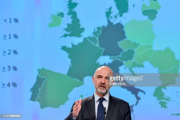 European Commissioner for Economic and Financial Affairs Taxation and Customs Pierre Moscovici gestures as he speaks during a press conference at the...