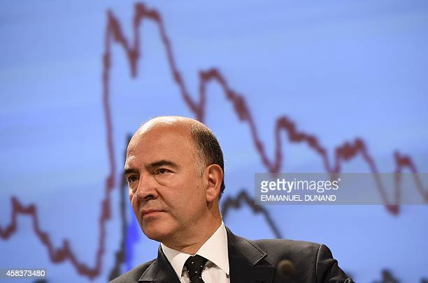 European Commissioner for Economic and Financial Affairs Taxation and Customs Pierre Moscovici looks on during a press conference on European...