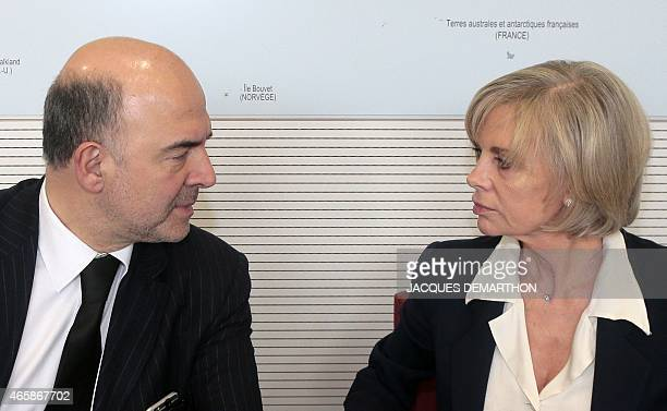 European Commissioner for Economic and Financial Affairs Taxation and Customs Pierre Moscovici speaks with French Socialist member of Parliament and...