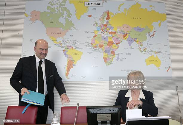 European Commissioner for Economic and Financial Affairs Taxation and Customs Pierre Moscovici arrives to sit next to French Socialist member of...