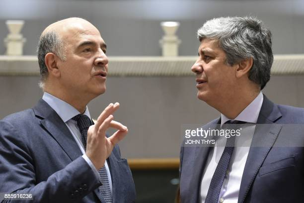 European Commissioner for Economic and Financial Affairs Taxation and Customs Pierre Moscovici talks with new head of the Eurogroup Portuguese...