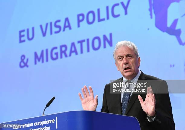 European Commissioner for Migration Dimitris Avramopoulos addresses a press conference at the European Commission in Brussels on March 14 2018...