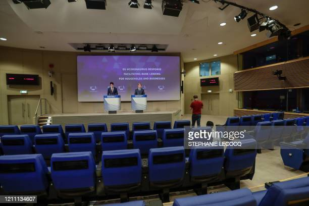 European Commissioner in charge of Economy Valdis Dombrovskis gives a press conference in an empty room on a banking package to facilitate lending to...