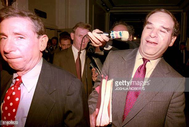 European Community Trade Commissioner Leon Brittan ducks a microphone from a reporter as he and US Trade Representative Mickey Kantor leave a press...