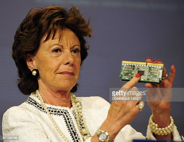 European competition commissioner Neelie Kroes shows an Intel processor during a press conference on May 13 2009 at EU headquarters in Brussels Intel...