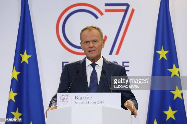 European Council President Donald Tusk addresses media representatives at a press conference in Biarritz southwest France on August 24 on the first...